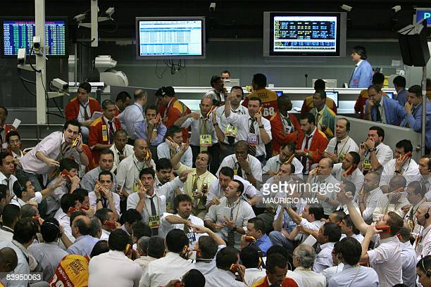 Stock traders negotiate in the iBovespa future index pit during the morning session at the Mercantile and Futures Exchange in Sao Paulo Brazil on...