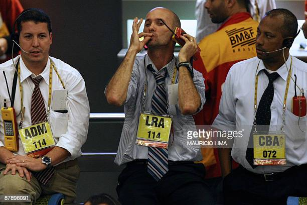 Stock traders negotiate in the iBovespa future index pit during the morning session at the Mercantile and Futures Exchange in Sao Paulo Brazil on May...