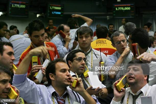 Stock traders negotiate in the interest rate future index pit during the morning session at the Mercantile Futures Exchange in Sao Paulo Brazil 29...