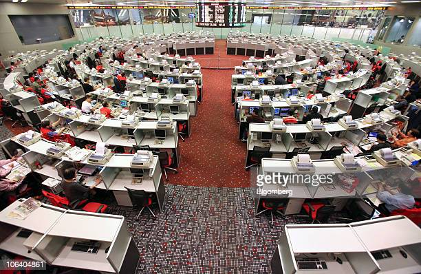 Stock traders work on the trading floor at the Hong Kong Stock exchange in Hong Kong China on Thursday Oct 29 2010 AIA Group Ltd rallied 17 percent...
