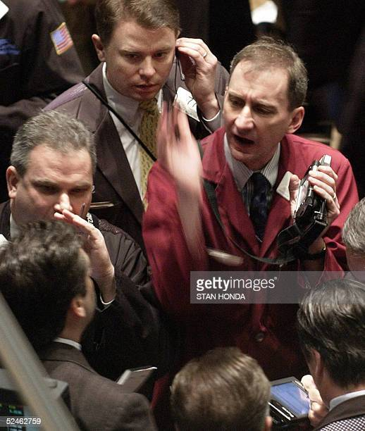 Stock traders work the floor of the New York Stock Exchange just after the opening bell 21 March 2005 Wall Street shares opened mixed 21 March as the...