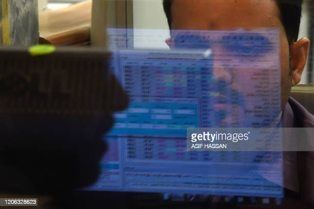 A stockbroker monitors the latest share prices during a trading session at the Pakistan Stock Exchange in Karachi on March 10 2020
