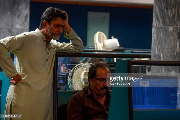 Stockbrokers monitor latest share prices during a trading session at the Pakistan Stock Exchange in Karachi on January 6 2020