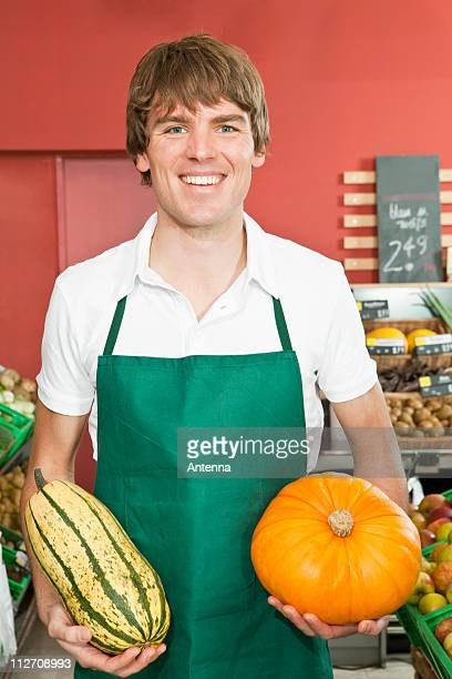 A stocker holding two varieties of winter squash
