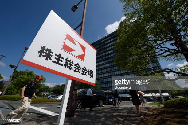 Stockholders arrive at the Toyota Motor Corp. Headquarters for the annual shareholders' meeting in Toyota, Aichi Prefecture, Japan, on Thursday, June...