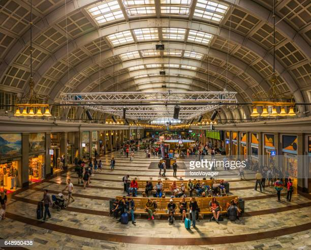 Stockholm Central Station concourse crowds waiting for railway trains Sweden