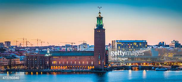 Stockholm City Hall Stadshus Riddarfjarden waterfront panorama illuminated sunset Sweden