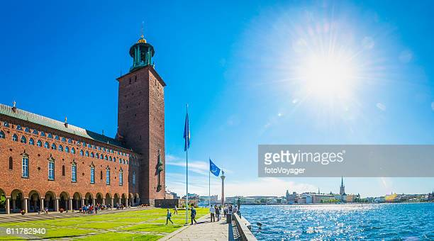 Stockholm City Hall tourists enjoying summer sunshine Gamla Stan Sweden