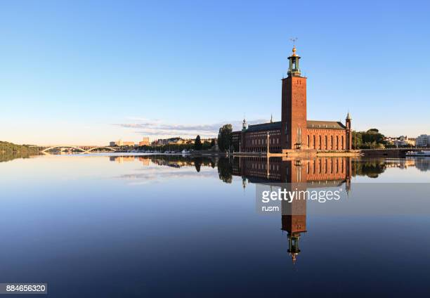 stockholm city hall with reflection on calm water - town hall stock pictures, royalty-free photos & images