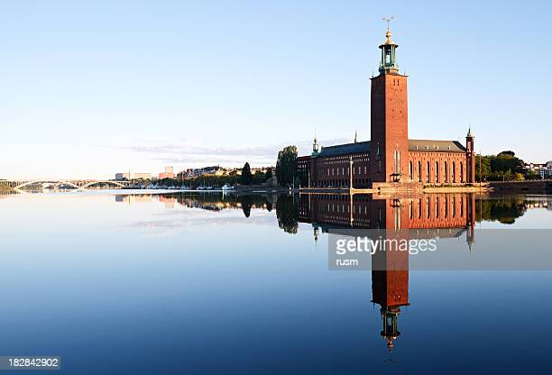 stockholm city hall with reflection on water - stockholm stock pictures, royalty-free photos & images