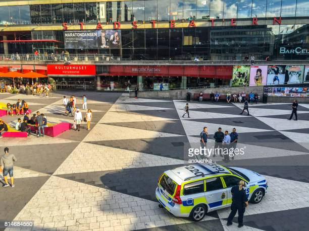 Stockholm city square with police car and people enjoying summer, Sweden