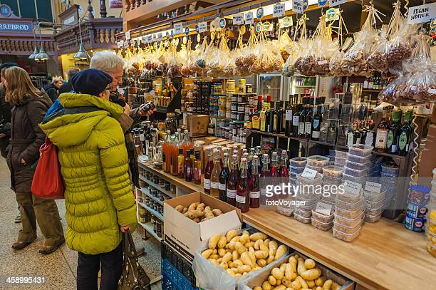 Stockholm couple shopping in Ostermalms Saluhall market Sweden