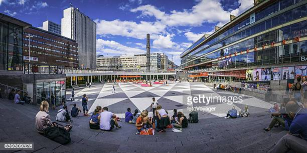 Stockholm crowds of shoppers in Sergels Torg square panorama Sweden