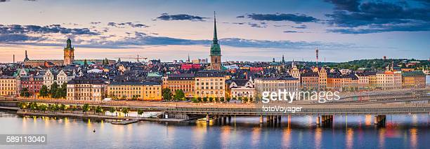 stockholm gamla stan waterfront cityscape illuminated panorama at sunset sweden - stockholm stock pictures, royalty-free photos & images