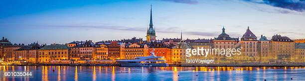 Stockholm Gamla Stan waterfront hotels spires illuminated sunset panorama Sweden