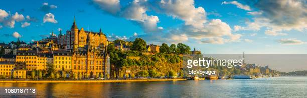 stockholm golden sunset light on sodermalm harbour waterfront panorama sweden - stockholm stock pictures, royalty-free photos & images