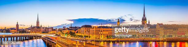 Stockholm lamplit sunset City Hall Gamla Stan spires panorama Sweden