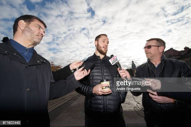 Stockholm native Fredrik Claesson of the Ottawa Senators is interviewed by Canadian media during a walking tour on November 8 2017 in Stockholm Sweden