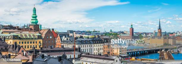 stockholm panoramic cityscape from sodermalm to glamla stan waterfront sweden - town hall stock pictures, royalty-free photos & images