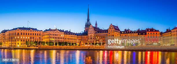 Stockholm spires and restaurants Gamla Stan illuminated dusk panorama Sweden
