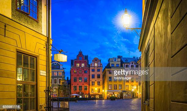 stockholm stortorget iconic gamla stan square illuminated at night sweden - stockholm stock pictures, royalty-free photos & images