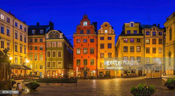 stockholm stortorget medieval square colorful townhouses restaurants gamla stan sweden - stockholm stock pictures, royalty-free photos & images