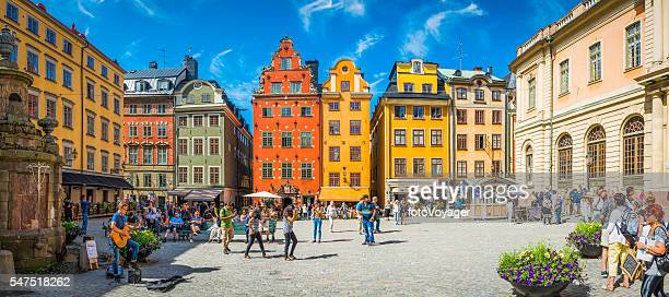 Stockholm Stortorget tourists in medieval square colourful houses restaurants Sweden