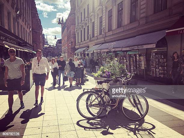 Stockholm street with cafe and tourists, Sweden