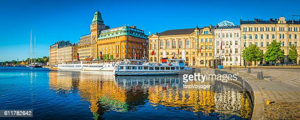 stockholm summer sunrise on nybroviken harbour hotels ferries panorama sweden - stockholm stock pictures, royalty-free photos & images