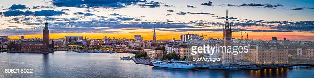 Stockholm sunset spires City Hall illuminated waterfront cityscape panorama Sweden