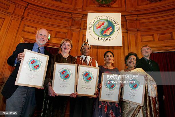 2005 Prize winners of the Right Livelihood Awards also known as alternative Nobels show their awards at a prize ceremony in the Government House 09...