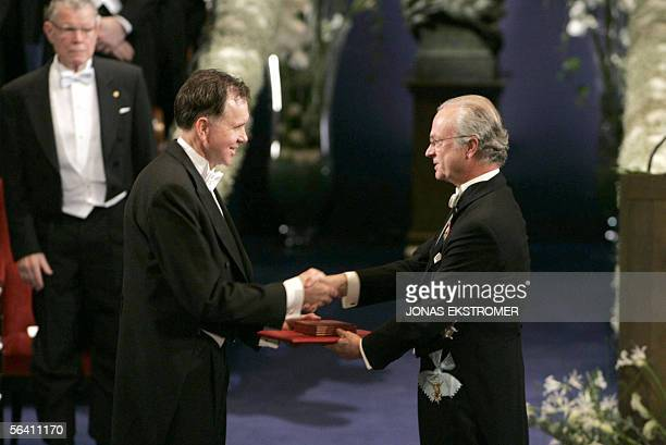 Australian Barry J Marshall receives the Nobel Prize in Medicine from King Carl XVI Gustaf of Sweden during a ceremony at the Concert Hall in...