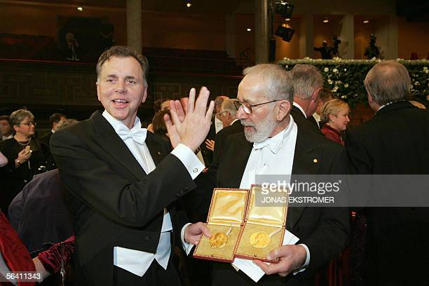 Australian Nobel Prize laureates Barry J Marshall and J Robin Warren exchange a high five to celebrate their shared Nobel Prize in Medicine after the...