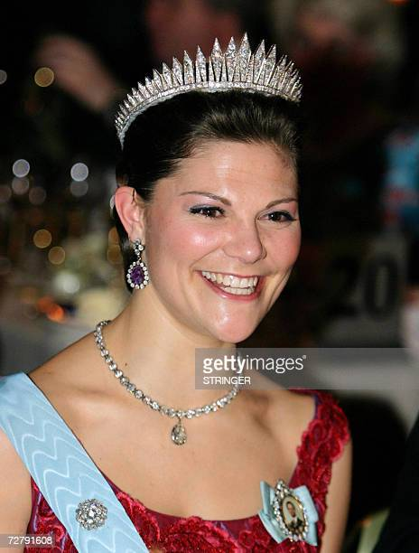 Crown Princess Victoria of Sweden poses at the table of honour during the Nobel Banquet at Stockholm City Hall for 1300 guests, including the Nobel...