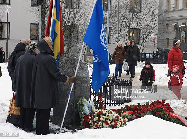 Flagbearers stand with UN Swedish and a flag representing the Social Democratic movement behind the grave of former Swedish Prime Minister Olof Palme...