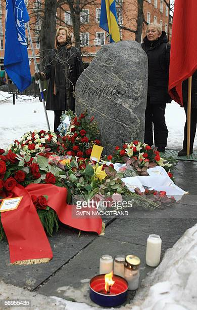 Flagbearers stand with United Nation Swedish and a flag representing the Social Democratic movement behind the grave of former Swedish Prime Minister...