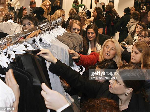 Frenzied customers more or less grabbs what they can as Swedish lowcost fashion giant Hennes and Mauritz's in Stockholm opened their doors at 1000 am...