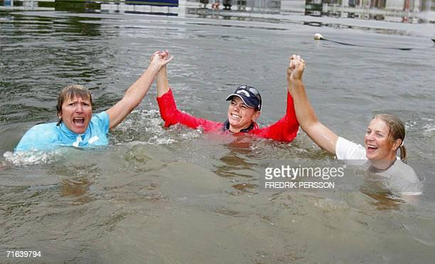 Golfer Swedish Annika Sorenstam her mother Gunilla and sister Charlotta jump in the wather after Annika won the Scandinavian TPC golf tournament in...
