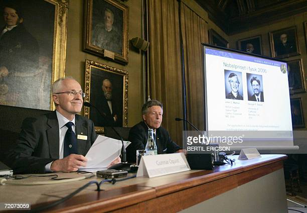 Gunnar Oquist permanent secretary of the Royal Academy of Sience and Per Carlson chairman of the Nobel committee announce the Nobel prize winners in...