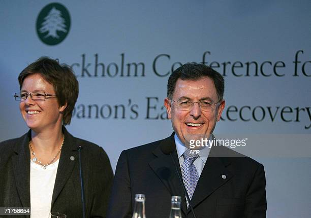Lebanon's Prime Minister Fouad Siniora laughs with Sweden's Minister of International Development Carin Jamtin at the concluding press conference of...