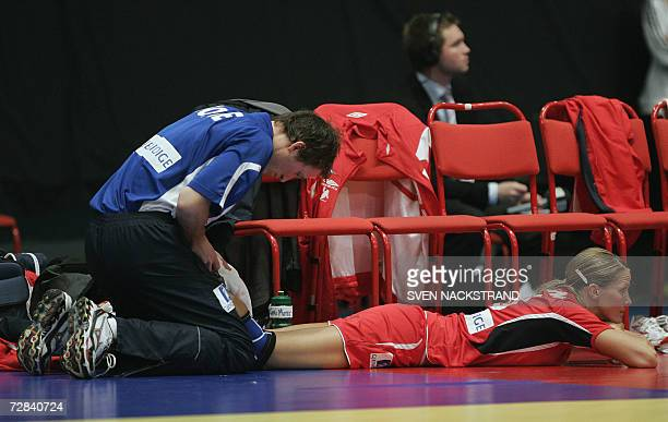 MVP of the tournament Norwegian captain Gro Hammerseng gets treatment for an injury and plays no more in the match where Norway beat Russia to win...