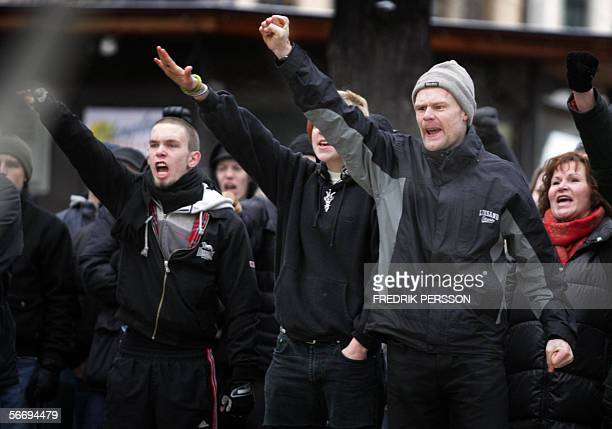 Neo nazi demonstrators make the facist salute during a neo nazi demonstration in Stockholm 28 December 2006 Neo nazis clashed with counter...