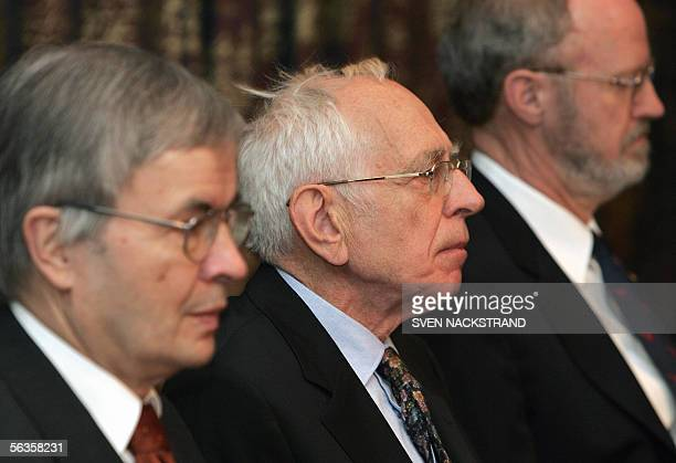 Nobel Prize winner in Chemistry 2005 French Yves Chauvin is seated between German Theodor W Hnsch and US Robert H Grubbs during a press conference in...