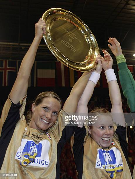 Norwegian captain Gro Hammerseng lifts the European Championships trophy together with Karoline Dyhre Breivang after their victory against Russia in...