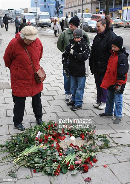 People stop 28 February 2006 at the place where former Swedish Prime Minister Olof Palme was assasinated 20 years ago 28 February 1986 in Stockholm...