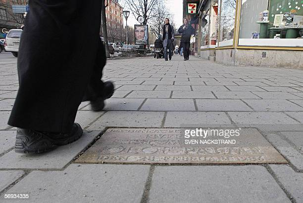 People walk 04 February 2006 at the place where in 28 February 1986 former Swedish Prime Minister Olof Palme was assassinated in Stockholm Two...