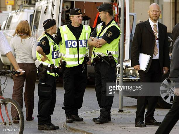 """Police stand guard near the Grand Hotel in Stockholm during the opening of the """"Stockholm Conference for Lebanon's Early Recovery"""" 31 August 2006...."""