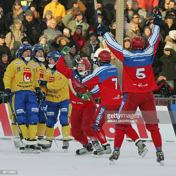 Russia's Jevgenij I Vanushkin and his team mates celebrate their win in front of Swedish players during their World Bandy Championships final match...