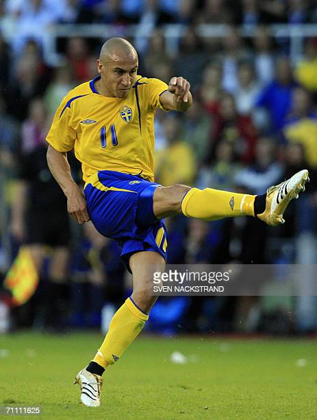 Sweden's Henrik Larsson shoots as Sweden plays a draw against Chile 11 in Solna Stockholm 02 June 2006 in a friendly match in preparation for the...