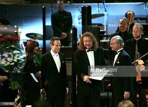 Swedish King Carl XVI Gustaf poses for a picture with members of British rock band Led Zeppelin John Paul Jones and Robert Plant , and Zoe Bonham ,...